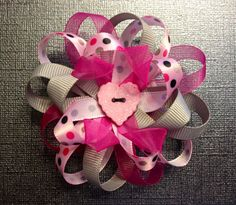 Pink and grey flower style bow.