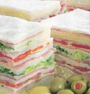 Sandwiches de miga simples y triples (super-thin tea sandwiches) - these are served for special occasions or gatherings