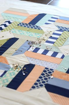 Jellybean baby quilt- basting by croskelley, via Flickr. Great for all the new babies coming up