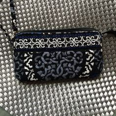 Vera Bradley Wristlet EUC colors Bright Perfect size! Approx 8X4 with strap Please check out my closet I have numerous VB items and am willing to BARGIN! Zip works great, interior stain free also has small inside zip pocket, only issue in this PreLoved beauty is a small stain by Zip on outside I have documented for you Vera Bradley Bags Clutches & Wristlets