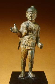 Bronze Soldier Etruscan early 3rd Century BC The youthful soldiers helmet has cheekpieces that frame his face. He wears a tunic beneath a cuirass (breastplate). A sheathed sword is under his right arm. His left hand is pierced to hold an object, probably a spear. Source: The Walters Art Museum