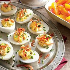 Muffuletta Deviled Eggs | This easy appetizer melds the flavors of olives, egg, and salty salami. | SouthernLiving.com