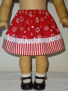 The skirt is red with small white stars. The skirt bottom is made from a red and white stripe with white lace trim. It has elastic waist. Seams are serged. Made in a smoke free home. Shipped priority mail ($6.00).
