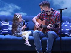 After 4-year-old Claire and her dad Dave's web video stole hearts around the world with more than 150 million views online, they came to Ellen's show to perform their duet live! Watch their sweet sit-down with Ellen!…