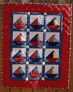 "An adorable baby quilt perfect for all of those boys coming this summer. The finished quilt is 33"" X 41"" . Fabrics are mostly Moda and Lecien. The colors are in a classic Nautical Theme. Machine quilted and machine pieced, beautiful workmanship."