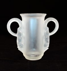 "Thibet Vase, a clear frosted glass vase by Rene Lalique, entitled ""Thibet"". Made in France. Created August 31st, 1931. Signature: R. Lalique"