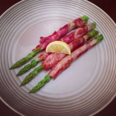 Prosciutto wrapped asparagus. Great #paleo snack!