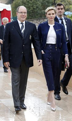 Prince Albert II of Monaco (L) and Princess Charlene arrive to attend the Monte-Carlo ATP Masters Series Tournament final tennis match between Spain and France, on April 17, 2016 in Monaco.