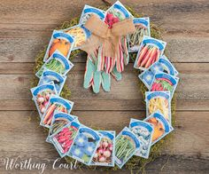 How To Make A Spring Wreath With Seed Packets. #springcraft #craftsforadults #springwreath #dollarstorecrafts