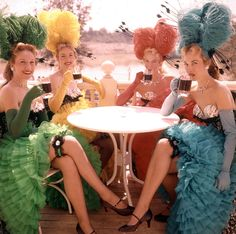 Showgirls enjoy a fantastic view of the Rivers of America from atop the Golden Horseshoe Saloon. (18 color photos of Disneyland 1955)