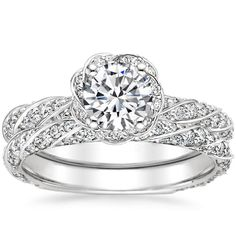 Mesmerizing ribbons of metal and pavé diamonds twist around the band and center gem of this unique halo ring. Available in White Gold. Vintage Engagement Rings, Diamond Engagement Rings, Halo Engagement, Engagement Ideas, Halo Diamond, Diamond Rings, Bridesmaid Jewelry Sets, Eternity Ring, Beautiful Rings