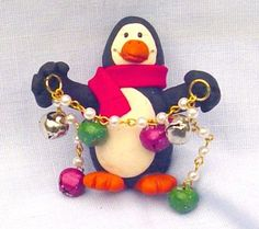 Handmade Polymer Clay Jingle Penguin Pin with Red and Green Bells | CreativeCritters - Seasonal on ArtFire