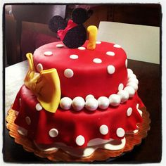Minnie Mouse Cake. Strawberry filled with strawberries and cream. Fondant decorations.