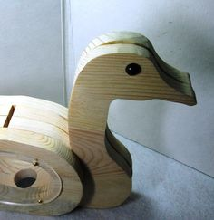 Hey, I found this really awesome Etsy listing at https://www.etsy.com/listing/150261152/wooden-duck-coin-bank-cute-handmade-toy