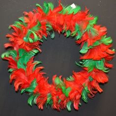 Add some charm to your Christmas decor with this red and green feather wreath.