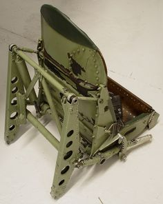Rear view of a rather beaten-up Spitfire seat. Shows connection point for Sutton harness