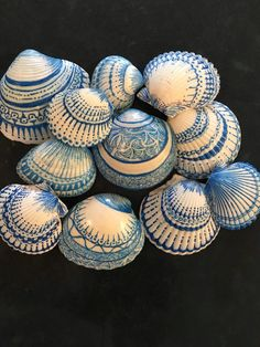 Using Pigma Micron pen and coated the the finished shells with Mod Podge sealant afterward. She had just started Zentangling and thinks she was influenced by that. Other people experimented eith actual Sharpie snd found it dmudged. I'm so attracted to these. Just one more reason to get to Sanibel Island. . . .