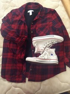 Casual fall outfit with red/black plaid button up shirt, black v-neck cami, white high-top converse, and black jeans (:
