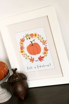 Switch out your standard artwork for something autumnal. This sweet print made with graphics from The Ink Nest is an adorable choice.  Get the printable at The Tomkat Studio.    - CountryLiving.com