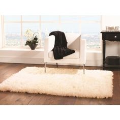 Super soft Sheepskin Rug in Ivory. The 8.1cm pile creates an excellent feeling under your feet. Made from 100% polyester. http://www.therughouse.co.uk/sheepskin-rugs