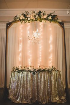 Gold linen. String lights. White flowers. Buds Etc. + KL Weddings & Events, LLC.