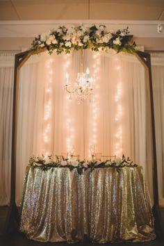 Gold linen. String lights. White flowers. Buds Etc. + KL Weddings & Events, LLC.