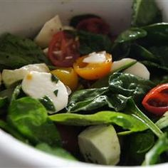 Spinach Caprese Salad - A greener version of the classic Caprese, this salad is just as delicious with the added nutrients of spinach! The drizzle of olive oil and balsamic vinegar make a wonderful dressing for the spinach underneath.
