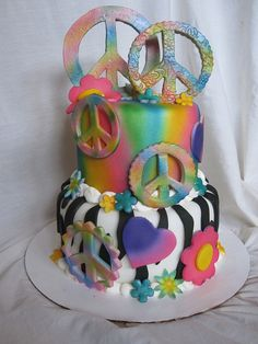 Multi colored peace sign cake by Charley And The Cake Factory, via Flickr