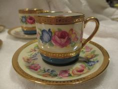An exquisite set of four late 19th century Limoges France handpainted and heavily gilt demitasse cups and saucers. This set comprises four (4) cups and saucers (see my other auctions for a matching se