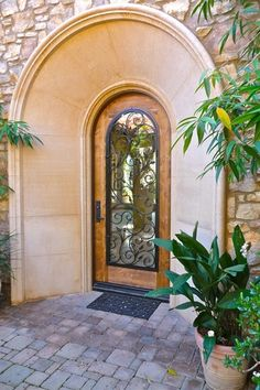 Mediterranean Front Door with Custom Pre-Cast Coral Door and Window Surrounds, Borano Custom Door, exterior tile floors