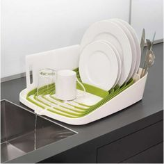 Neat. Dish drying rack that drains into the sink.