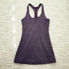 NIKE Dri-Fit Racerback Tank Heather purple.  In excellent condition.  No trades.  {#10150} Nike Tops Tank Tops