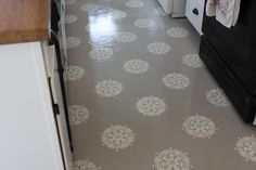 STENCILED PAINTED FLOORS!!!! This was painted over linoleum but I want to do it on concrete