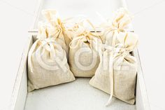 Qdiz Stock Photos | Textile sachet pouches,  #background #bag #bow #box #burlap #cloth #container #craft #decoration #decorative #fabric #filled #gift #handmade #homemade #isolated #material #package #packaging #packet #poke #pouch #present #ribbon #sac #sachet #sack #small #sparse #textile #white