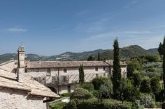 "This stylish convent-turned-design-hotel enjoys a quiet spot in the historical heart of Assisi. An inspired renovation not only transformed the 13th-century structure into a sleek, minimalist haven; but also uncovered the ruins of a Roman amphitheater – now home to an atmospheric ""spa museum"". Umbria Italy, Boutique Hotels, Nun, Statue Of Liberty, Europe, Travel, Statue Of Liberty Facts, Viajes, Trips"