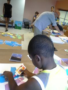 Steve Keene, artist, facilitates an art workshop this summer for children at the Central Branch of the Brooklyn Public Library. July 26, 2014.