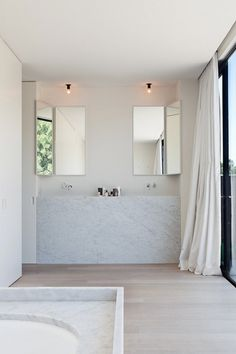 Badezimmer /Bathroom White bathroom with concealable vanity mirrors. Photo by Tim Van de Velde. Laundry In Bathroom, Bathroom Inspo, Bathroom Inspiration, Small Bathroom, White Bathrooms, Master Bathroom, Bathroom Marble, Minimal Bathroom, Modern Bathrooms