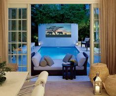 Palm Beach home of designer, Campion Platt. The courtyard pool's fountain-wall doubles as a movie screen.
