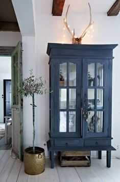 .love this painted blue cabinet