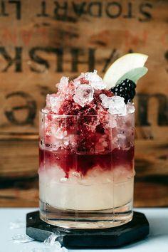 italian bramble cocktail: dry gin, lemon juice, simple syrup, and crème de mûre (blackberry liqueur)