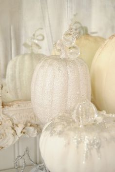 "*Plastic pumpkins $1 - $7 each at your local craft or discount store. *Hot glue gun *Glue sticks *Glue *1"" – 2"" Paint brush *Various paints in shades of white and cream *Embellishments (I found the glass 'diamonds' in the vase filler aisle, and the tendrils and leaves in the Holiday floral pick bins at Michael's. I placed vintage rhinestone earrings on a few, beads on others, and sequins off a broken pair of flip-flops.) *Glitter"