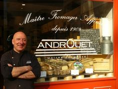 Androuet Rue Mouffetard, 134, rue Mouffetard –  Metro: Censier Daubenton (line 7). other locations here: http://www.kwintessential.co.uk/articles/france/Best-Cheese-in-Paris/623  Taking back cheese to the US is fine as long as it's hard cheese. If you tell the staff at Androuet you are buying to take the cheese home they'll even provide you with a vacuum sealed tub. You should, however, check with the department of agriculture or US customs and borders before you travel as rules can change.