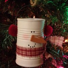 Snowman ornament.  I'm thinking tomato paste cans would be a good size? Change red to blue.