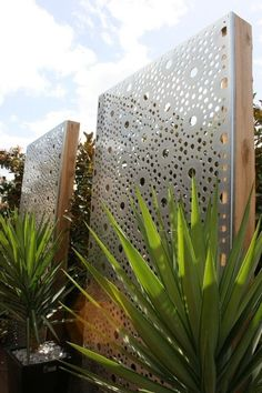 These gorgeous laser cut privacy screens create structure and visual appeal that accents landscaping. Wall Art Sculpture | The Block Shop #LandscapingLighting