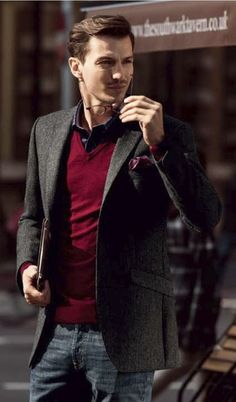 Shop this look for $160:  http://lookastic.com/men/looks/jeans-and-v-neck-sweater-and-blazer-and-pocket-square-and-longsleeve-shirt/710  — Navy Jeans  — Red V-neck Sweater  — Charcoal Blazer  — Purple Polka Dot Pocket Square  — Navy and White Gingham Longsleeve Shirt