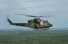 """USAF 91st Missile Wing """"Rough Riders"""", 54th Helicopter Squadron Ellsworth AFB, South Dakota. The Vietnam War-vintage Huey at Ellsworth AFB provides search and rescue capabilities."""