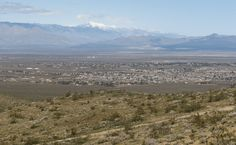 Aerial view with property outlined in redPlat mapNeighboring areaSurrounding areaView from end of pavement on Dolphin Ave toward the landThe mountains of Ridgecrest