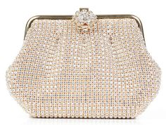 This evening bag is dripping with Swarovski crystals and a floral-shaped clasp, and has a Roaring 20s French opulence feel #weddingaccessories