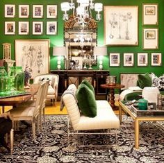 Living space with lots of wall pictures and emerald green paint.jpg