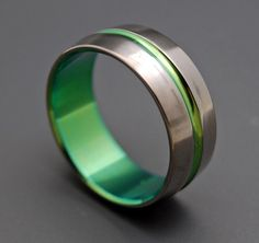 Inspired by Green Lantern  Titanium Wedding Bands by MinterandRichterDes, $120.00 I've see others inspired by green lantern, and there cool. But non of them made me want them for my ring like this does! lol